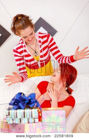 Smiling Girl Making Surprise For Her Girlfriend