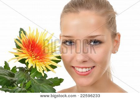 Smiling woman shows a flower