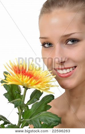 Woman with blue eyes holding a flower