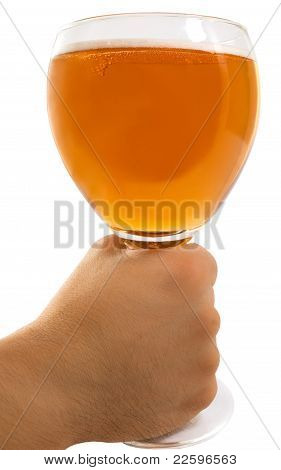 Man's Hand Holding Up A Glass Of  Beer