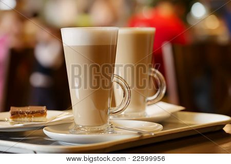 coffee latte in two tall glasses, shallow dof