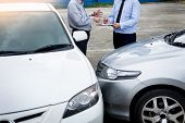 Insurance Agent Writing On Clipboard While Examining Car After Accident Claim Being Assessed And Pro poster