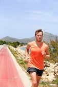 Exercise outdoor fitness man jogging on street training cardio outside in summer heat sweating. Spor poster