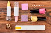 Flat Lay Cosmetics On Brown Wooden Background. Beautiful Composition Of Decorative Cosmetics And Jew poster