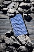 Exclusive Blue Snake Leather Case For Smartphone.luxury Case. On Stone Background poster