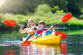 Kids Kayaking In Ocean. Children In Kayak In Tropical Sea. Active Vacation With Young Kid. Boy And G poster