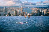 Lady Swim In Root Top Swimming Pool In Luxury Hotel With Hong Kong City Backgroung, Hongkong Island, poster