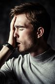 Portrait of a handsome man is thinking hard about something. The power of thought, brainstorming. Bu poster