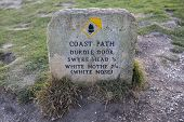 A Marker On The South West Coast Path Showing Directions To Durdle Door, Swyre Head And White Nothe  poster