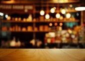 Top Of Nature Wood With Blur Bokeh Lamp Light Bar Or Club Cafe Background poster
