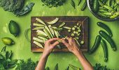 Healthy Green Vegan Cooking Ingredients. Flay-lay Of Female Hands Cutting Green Vegetables And Green poster