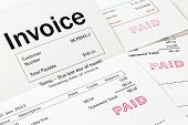 Invoice With Paid Stamp - Three Invoices With Paid Stamped On Them. All Details Are Imaginary. poster