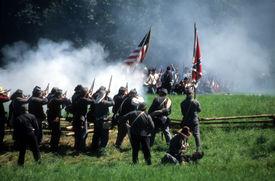 image of rebs  - Confederate soldiers advance Civil War battle reenactment  - JPG