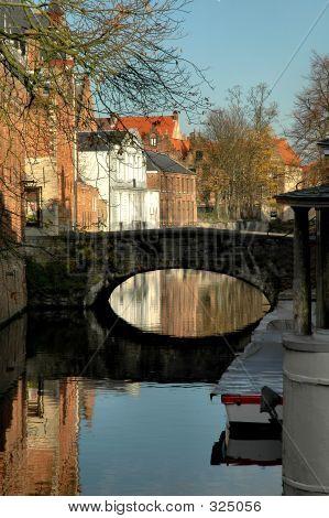 Bridge Along Canal In Brugges, Belgium