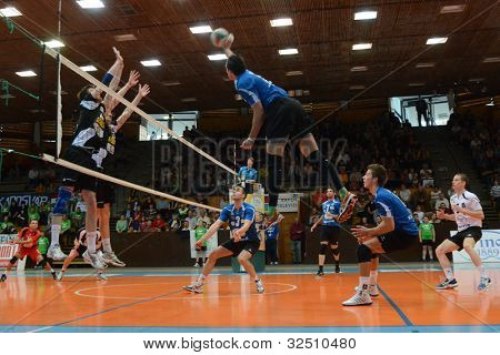 KAPOSVAR, HUNGARY - APRIL 21: Andras Geiger (with ball) in action at a Hungarian National Championship volleyball game Kaposvar (blue) vs. Kecskemet (black), April 21, 2012 in Kaposvar, Hungary.