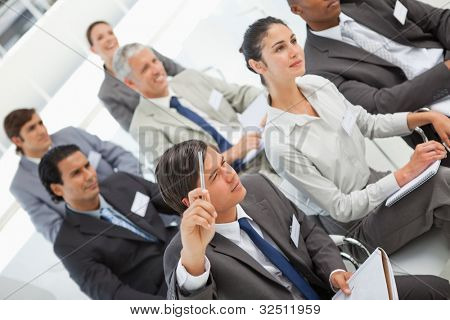 A man is asking a question at a business meeting