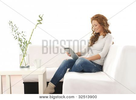 Young attractive woman with a tablet in modern interior