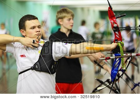 MOSCOW - APRIL 2: Young archers at Traditional Archery Championship among adults (undergraduate and graduate) of Russian Institute of Physical Education, on April 2, 2011 in Moscow, Russia.