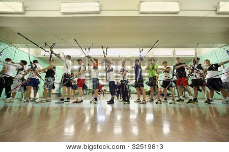 MOSCOW - APRIL 2: Students shot from bow at Traditional Archery Championship among adults (undergraduate and graduate) Russian Institute of Physical Education, on April 2, 2011 in Moscow, Russia.