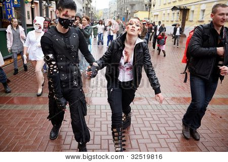 MOSCOW - MAY 14: Unidentified participants of Zombie Parade and casual passersby on Old Arbat, May 14, 2011, Moscow, Russia.