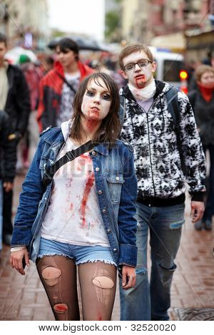 MOSCOW - MAY 14: A pair of unidentified made-up participants of Zombie Parade on Old Arbat, May 14, 2011, Moscow, Russia.