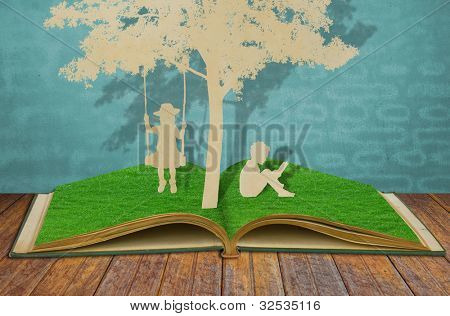 Paper cut of children read a book and children on swing under tree