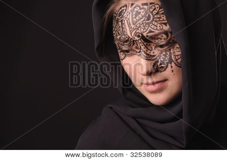 Arabic style portrait of young beauty woman with tracery on the face