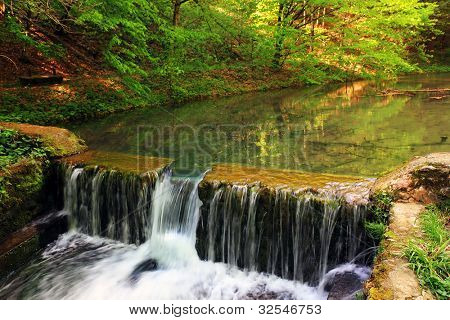 A manmade dam in a small river