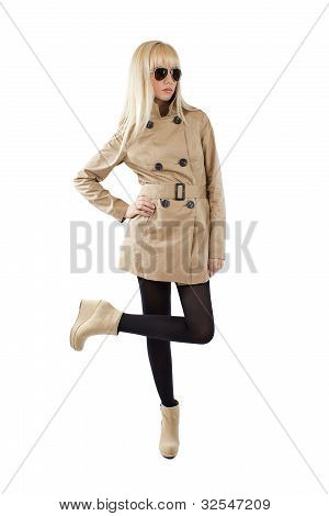 Beautiful Blonde Young Women Is Posing In A Trenchcoat