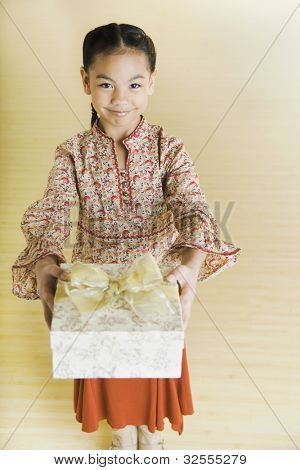 Portrait of Pacific Islander girl holding gift
