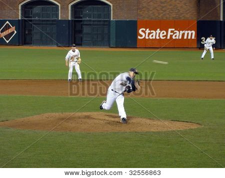Cal Pitcher Throws Pitch With Ball In Motion