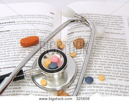 Stethoscope & Drugs On Medical Book
