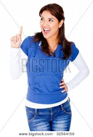 Happy woman pointing an idea with her finger - isolated over white