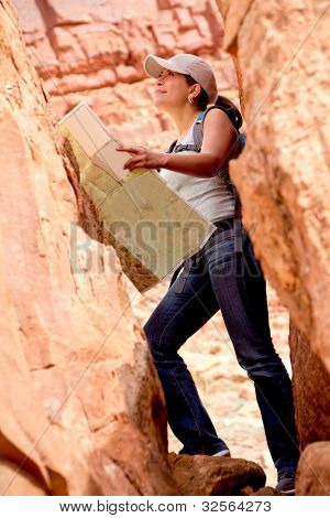 Adventurous woman exploring the desert holding a map