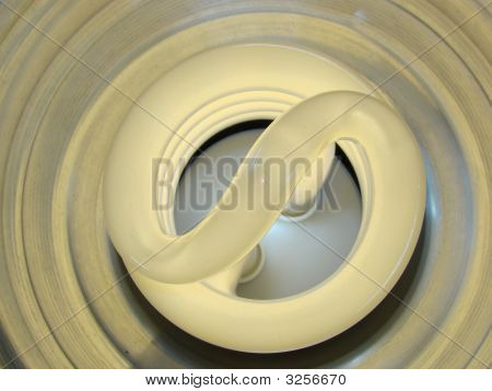 Compact Fluorescent Bulb Glowing In Reflector
