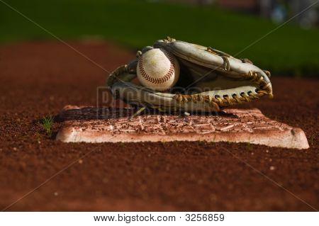 Baseball In Glove On The Field