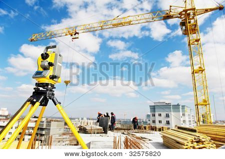 Surveying measuring equipment theodolite transit on tripod at construction building area site