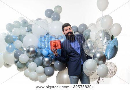 poster of Happy Birthday Guy Holds Helium Balloons And Gift Box. People, Joy, Birthday, Celebration. Festive E