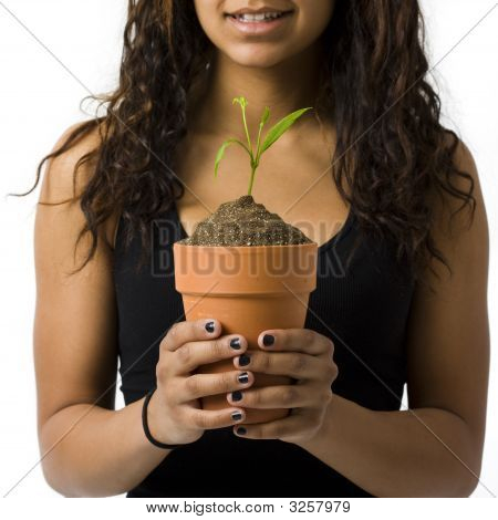 Girl With Potted Plant Smiles