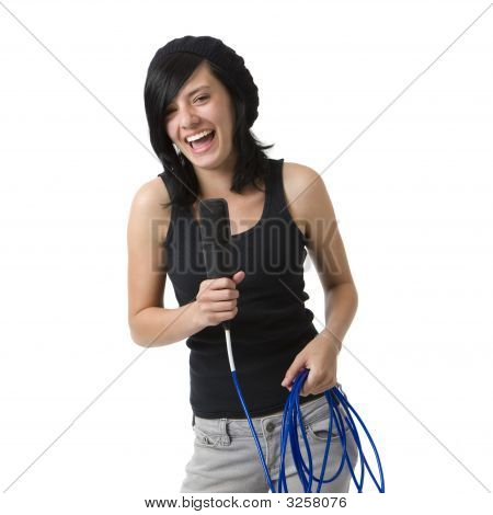 Girl With Mic Smiles And Sings