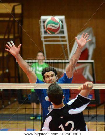 KAPOSVAR, HUNGARY - APRIL 21: Andras Geiger (in blue) in action at a Hungarian National Championship volleyball game Kaposvar (blue) vs. Kecskemet (black), April 21, 2012 in Kaposvar, Hungary.