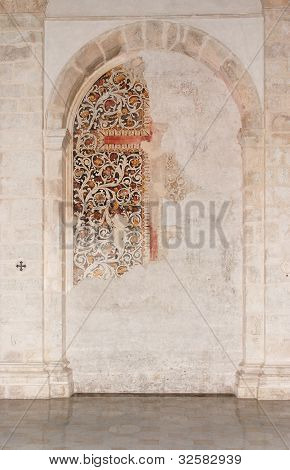 Semicircular niche with fresco remains in medieval church in Milazzo, Sicily