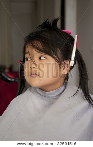 Young girl getting a haircut