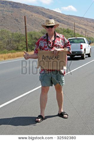 Hitchhiker with cardboard sign