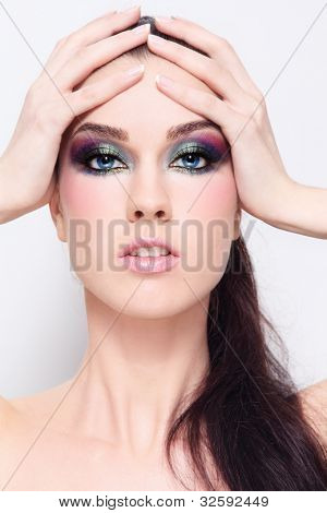 Young beautiful woman with fancy colorful make-up