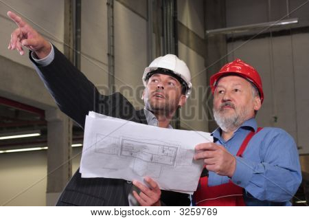 Professionals With Blueprints