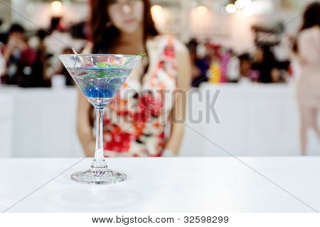 A Glass Of Blue Coctail (ole) And With Sexy Girl On Background