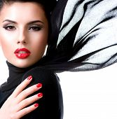 Portrait of a beautiful young woman with waving scarf. Glamour fashion model with bright gloss make- poster