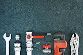 Repair Plumbing Background. Spanner And Fitting For Plumber. Copy Space. poster
