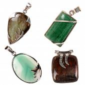 stock photo of labradorite  - A set of silver pendants having green jade green onyx jasper and labradorite stones - JPG